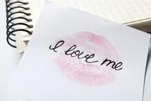 Phrase I Love Me And Lipstick Kiss Mark On Paper, Closeup