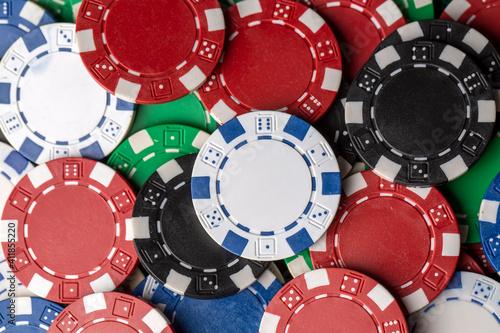 Colorful poker chips on green table. Gambling concept, background © Esin Deniz