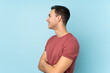 Leinwandbild Motiv Young caucasian handsome man isolated on blue background in lateral position