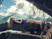 Girl Lying On A Fallen Tree By Lake Barrea, L'Aquila, Abruzzo, Italy