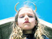 Portrait Of A Girl With Devil Horns