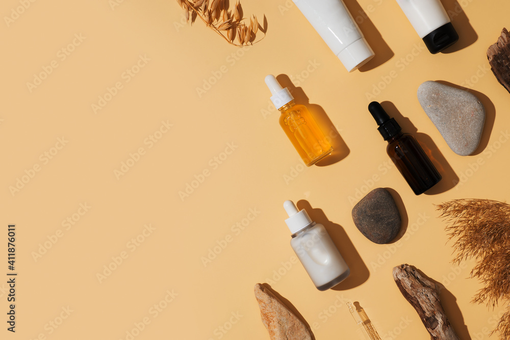 Fototapeta Natural cosmetic concept with serum and cream tube and bottles with natural materials