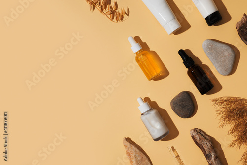 Fototapeta Natural cosmetic concept with serum and cream tube and bottles with natural materials obraz