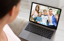 Millennial Woman Having Online Video Conference With Her Relatives On Laptop At Home