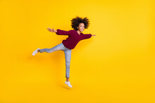 Full Body Profile Portrait Of Dark Skin Girl Hands Show Plane Figure Wear Pullover Isolated On Yellow Color Background