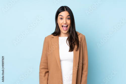 Obraz Young caucasian woman isolated on blue background with surprise facial expression - fototapety do salonu