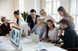 canvas print picture - Big group of business people analyzing marketing reports on computers together. Crowded shared office work space. Busy diverse millennial team discussing project, brainstorming at workplaces