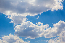 Sunny Summer Sky With Large Cumulus Clouds.