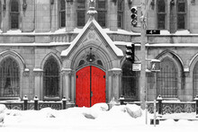 Red Church Door In Snowy Black And White Winter Street Scene On 4th Avenue In The East Village Of New York City