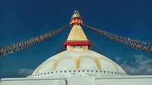 Low Angle View Of Boudhanath Temple Against Blue Sky