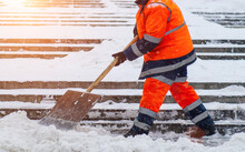 Snow Removal. Worker Clearing Snow By Shovel After Snowfall. Outdoors