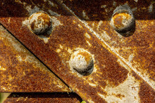 Metal Rivets On An Old And Rusted Metallic Bridge