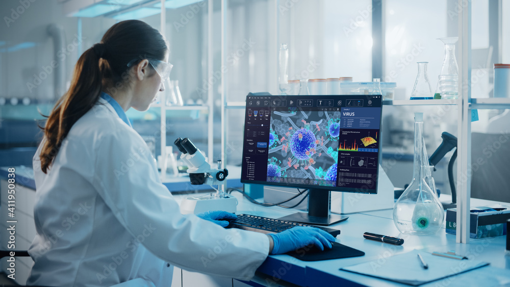 Fototapeta Advanced Medical Science Laboratory: Medical Scientist Working on Personal Computer with Screen Showing Virus Analysis Software User Interface. Scientists Developing Vaccine, Drugs and Antibiotics.