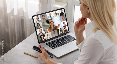 woman and team on laptop screen talking and discussion in video conference. Working from home, Working remotely, Self-isolation.