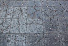 The Sidewalk Is Paved With Square Decorative Tiles.