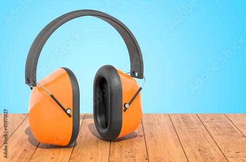 Photo Standard Ear Defenders on the wooden planks, 3D rendering