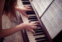 Close-up Of A Teenage Girl Playing The Piano