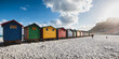 canvas print picture - Colorful beach cabins at sunset  in Muizenberg, Cape Town, South Africa