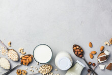 Directly Above Shot Of Various Food And Milk Over White Background
