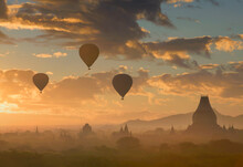 Silhouette Of Hot Air Balloons Flying Over Temples At Sunset, Bayan, Myanmar