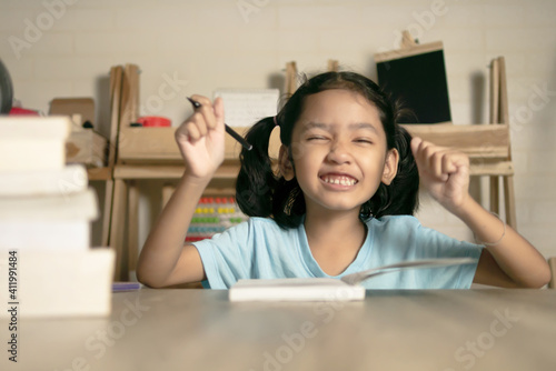Canvas Print Cute Girl Drawing On Book At Home
