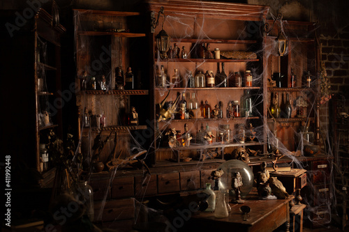 Stampa su Tela Halloween background Shelves with alchemy tools Skull spiderweb bottle with pois