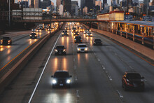 City Skyline And Cars Driving Along Freeway At Sunset, Chicago, Illinois, USA