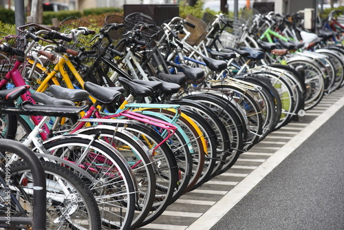 Obraz A view of the bicycle parking lot around the station in Japan. - fototapety do salonu