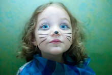 Portrait Of A Girl With Cat Whiskers Drawn On Her Face