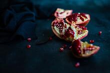 Organic Pomegranate Seeds On Black Background