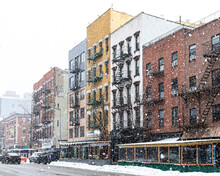 Winter Street Scene With Snowing Blowing Over The Buildings Along Avenue A In The East Village Neighborhood On New York City NYC