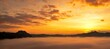 Leinwandbild Motiv Scenic View Of Dramatic Sky Over Silhouette Mountains During Sunset