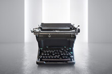 Close-up Of Typewriter On Table Against Wall