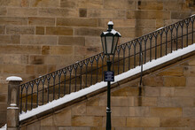 Lighting And Snowy Stairs On The Old Charles Bridge In The Center Of Prague During The Day In Winter 2021