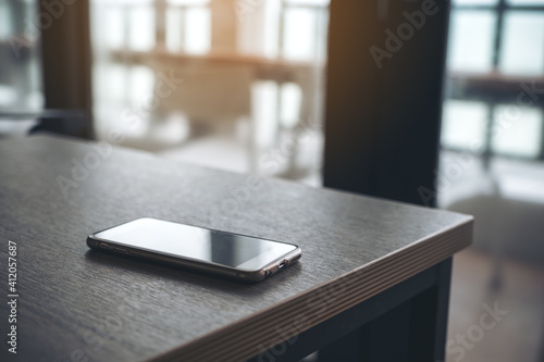 Close-up Of Mobile Phone On Table At Home