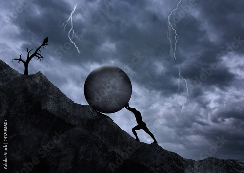 Fototapeta Young man pushing big rock uphill, surreal concept, challenge and hard work, strength and obstacle, difficulty and goal concepts
