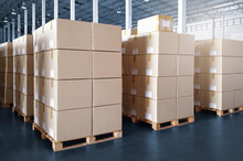 Interior Of Storage Warehouse With Stack Of Card Board Boxes On Pallet Rack. Shipping Warehouse. Cargo Export- Import.