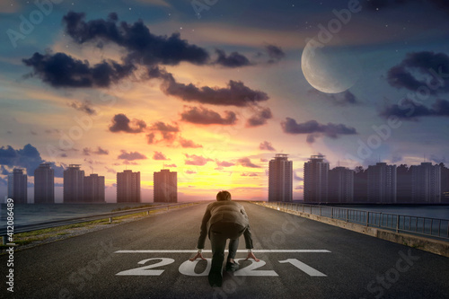 Business man --- line in front of city. Night back view. Elements of this image furnished by NASA.