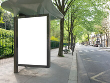 Bus Stop Billboard Mockup In Empty Street In Paris. Parisian Style Hoarding Advertisement Close To A Park In Beautiful City