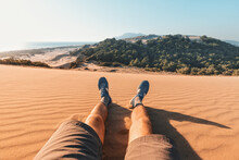 Feet Of A Traveler In Shorts And Hiking Shoes On The Background Of A Paradise Landscape With Golden Sand And Blue Sea In The Background. Lycian Way And Footpath Trail Concept
