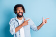 canvas print picture - Portrait of attractive cheerful guy demonstrating copy space good offer solution isolated over bright blue color background