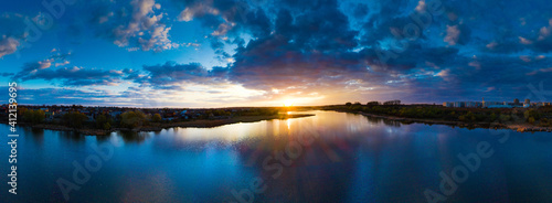 Fototapeta Beautiful sunrise and dramatic clouds on the sky. Flood waters of river. Panorama landscape obraz
