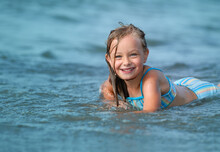 Smiling Cute Girl Playing In The Sea