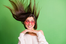 Photo Of Young Attractive Pretty Happy Smiling Dreamy Girl In Funky Glasses With Flying Hair Isolated On Green Color Background