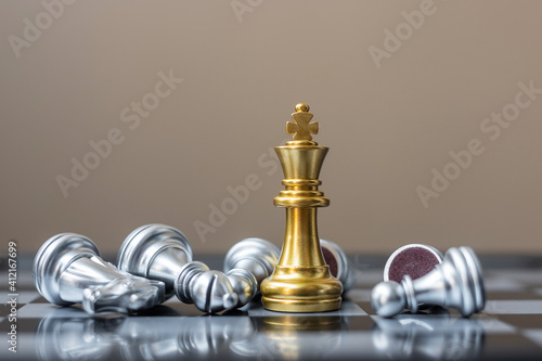Obraz na plátně gold Chess king figure stand out from crowd of enermy or opponent during chessboard competition