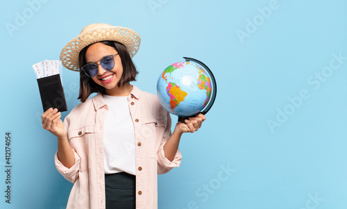 young pretty traveler woman with a world globe map. travel or holidays concept