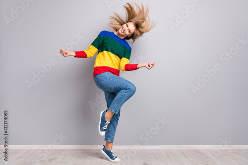 Full length body size photo of female student listening music dancing on floor at party isolated on pastel grey color background