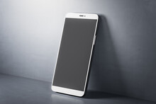 Mobile Smart Phone With Black Screen On Concerete Table