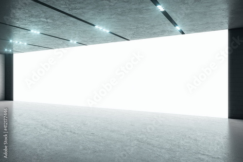 Obraz Big blank white screen on the wall for presentation in modern loft style room. Mockup. 3D rendering - fototapety do salonu