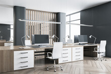 Modern Office Interior With Dark Wood Tables, Wooden Floor, Huge Windows And Massive Partition. 3D Rendering.
